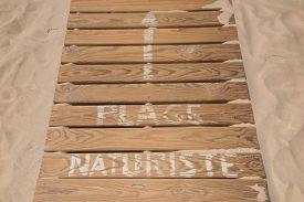 stock photo of naturist  - a Wooden walkway on a naturist beach - JPG