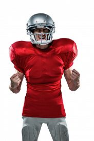 pic of irritated  - Irritated American football player in red jersey screaming against white background - JPG