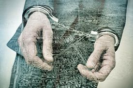 pic of land development  - double exposure of a handcuffed man and a tract housing development and a developing land - JPG