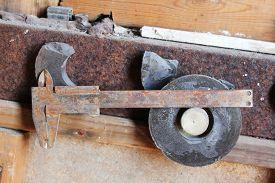 stock photo of vernier-caliper  - Rusty vernier caliper with magnets in garage - JPG