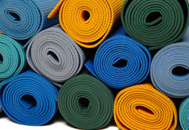 picture of yoga mat  - many colorfull yoga mats as a background - JPG