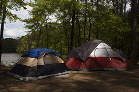 picture of nylons  - Campsite near a lake with two nylon tents up - JPG
