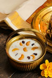 stock photo of pal  - Pudding Pal Payasam Kheer Indian food garnished with cashew and raisin Side View - JPG