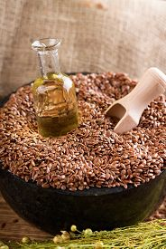 pic of flax seed oil  - Vertical photo with marble mortar bowl full of flax seeds - JPG