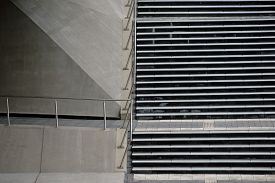 picture of underpass  - A staircase with a steel railing on the side of a bridge underpass - JPG