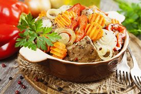 picture of liver fry  - Liver fried with paprika carrot and onion on the table - JPG