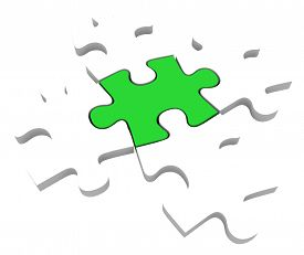 pic of uniqueness  - One unique green puzzle piece among 5 pieces to illustrate being different - JPG