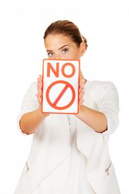 picture of bans  - Young businesswoman holding a board with ban - JPG