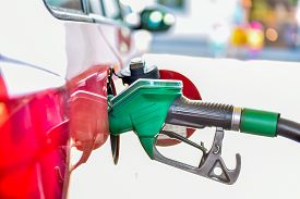 picture of tank truck  - Refueling a red car at the gas station - JPG