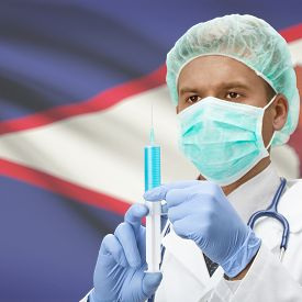 foto of samoa  - Doctor with syringe in hands and flag on background series  - JPG