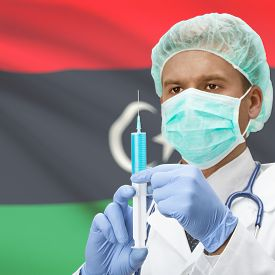 pic of libya  - Doctor with syringe in hands and flag on background series  - JPG