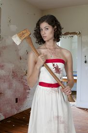 stock photo of possession  - Beautiful possessed woman in a trace holding an axe - JPG