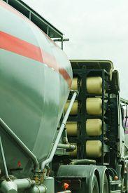 image of fuel tanker  - A Big Fuel Tanker Truck on the road background - JPG