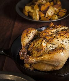 stock photo of pot roast  - High angle view of delicious roasted chicken - JPG