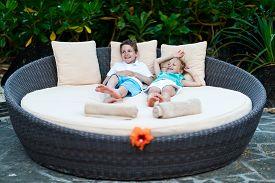 stock photo of cabana  - Kids at luxury resort relaxing at beach cabana - JPG