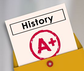 stock photo of yesteryear  - History report card opening from a yellow envelope to illsutrate a student has passed the class or course with an A plus score or grade - JPG