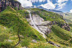 stock photo of rosa  - Glacier stream flowing down a valley - JPG