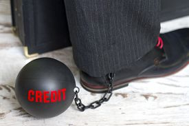 image of ball chain  - In slavery of credit concept with metal ball on chain and leg - JPG