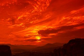 picture of trinity  - Famous lookout overlooking the city of Kalambaka at dramatic red sunset from the Monastery of the Holy Trinity - JPG