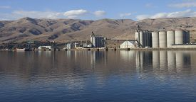 picture of barge  - Multiple grain elevators and barge on a river near Lewiston Idaho - JPG