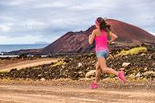 Trail runner athlete woman running training cardio on rocky mountain path on long distance endurance poster