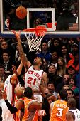 NEW YORK - JANUARY 17:  New York Knicks shooting forward Wilson Chandler (21) shoots a basket agains