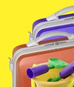 Two Suitcase And Toy Bucket And Spade poster