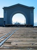 Arch At Embarcadero Pier In San Francisco, Old Ship Beyond poster