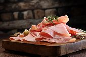 Sliced Ham On Wooden Background. Fresh Prosciutto. Pork Ham Sliced. poster