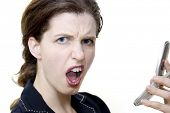 stock photo of frazzled  - puzzled woman on the phone - JPG