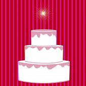 three tiered cake with stripe background and sparkler