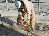 picture of bend over  - Worker Cutting Pavement - JPG