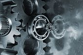 stock photo of mechanical engineering  - gears and bearings reflecting in titanium - JPG