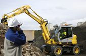 image of jcb  - engineer supervising digger - JPG