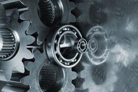 stock photo of mechanical engineer  - gears and bearings reflecting in titanium - JPG