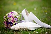 Brides Wedding Shoes, Purs And A Bouquet With Roses And Other Flowers On The Grass poster