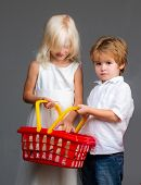 Couple Kids Hold Plastic Shopping Basket Toy. Mall Shopping. Buy With Discount. Buy Products. Play S poster