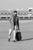 Carry Travel Bag. Man Bearded Hipster Travel With Luggage Bag On Wheels. Traveler With Suitcase Arri poster