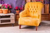Still Life Of Vintage Chair In Living Room.terrace Lounge With Comfortable Yellow Arm Chair, Divans  poster