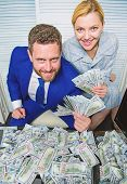 Huge Profit Concept. Financial Success. Man Businessman And Woman Secretary With Pile Dollar Banknot poster