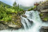 Waterfall In The Norwegian Town Geiranger Located On The Unesco-protected Geiranger Fjord poster