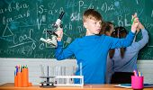 Students Doing Biology Experiments With Microscope In Lab. Happy Children. Chemistry Lesson. Little  poster