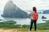 Back Side Of Asian Woman Traveler Looking The Map For Travel With Backpacker At Fantastic Landscape  poster