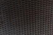 Wallpaper Texture Of Dark Brown Braided Plastic. poster