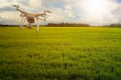 UAV drone multicopter flying with high resolution digital camera over a crops field, agriculture con poster