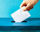 european Union parliament election concept - hand putting ballot in blue election box poster