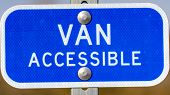 Clear Panorama Blue Sign With A Van Accessible Text On A Parking Area For Handicapped People poster