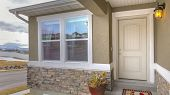 Panorama White Front Door And Reflective Window Of A Home Against Road And Cloudy Sky poster