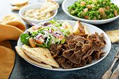 Mediterranean Food On The Table, Gyro Platter, Pita And Dips And Tabbouleh poster