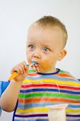 Cute Infant Eating Messily